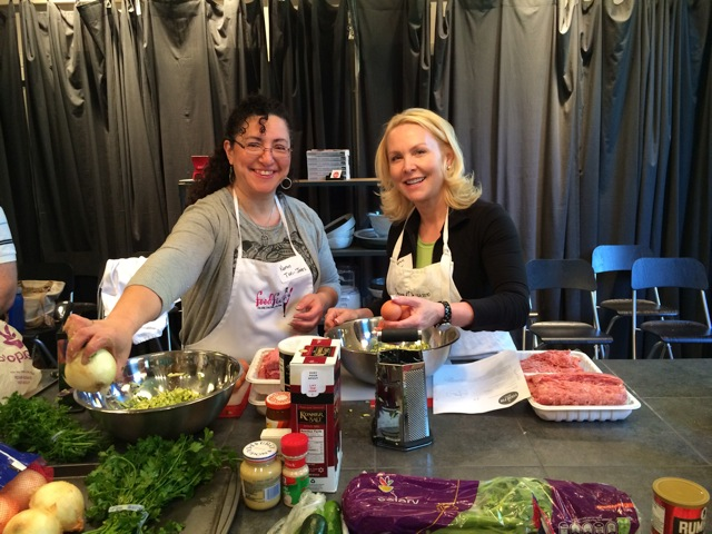 Karen Tovi-Jones and Maureen Weiner preparing food for clients of Jewish Family Service.
