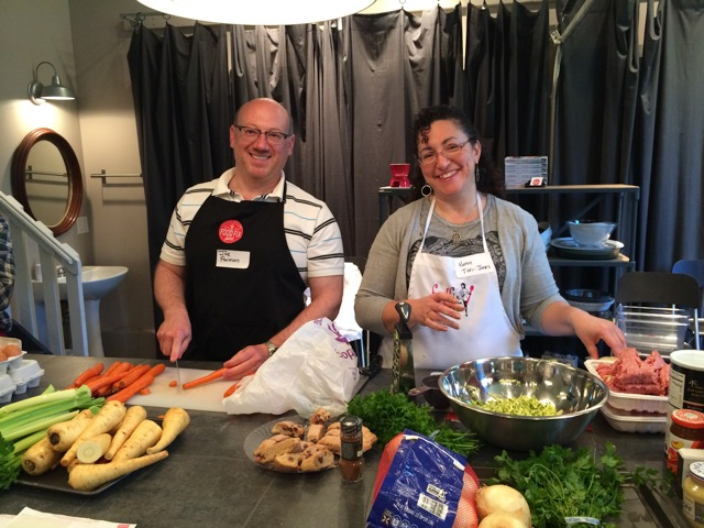 Rabbi Joseph M. Forman and Karen Tovi-Jones preparing food for clients of Jewish Family Service.