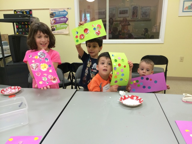 Amanda Korfin, Jake Korfin, Nate Freda, Andy Freda with art projects created for residents of Independence Manor